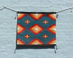 Hand woven southwest print saddle blanket in blue and orange