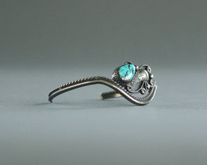 asymmetrical turquoise and silver bracelet