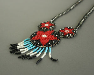 Beaded medallion necklace with red stars