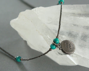 tarnished liquid silver necklace with teal pendant