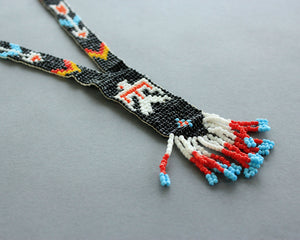 black beaded thunderbird necklace