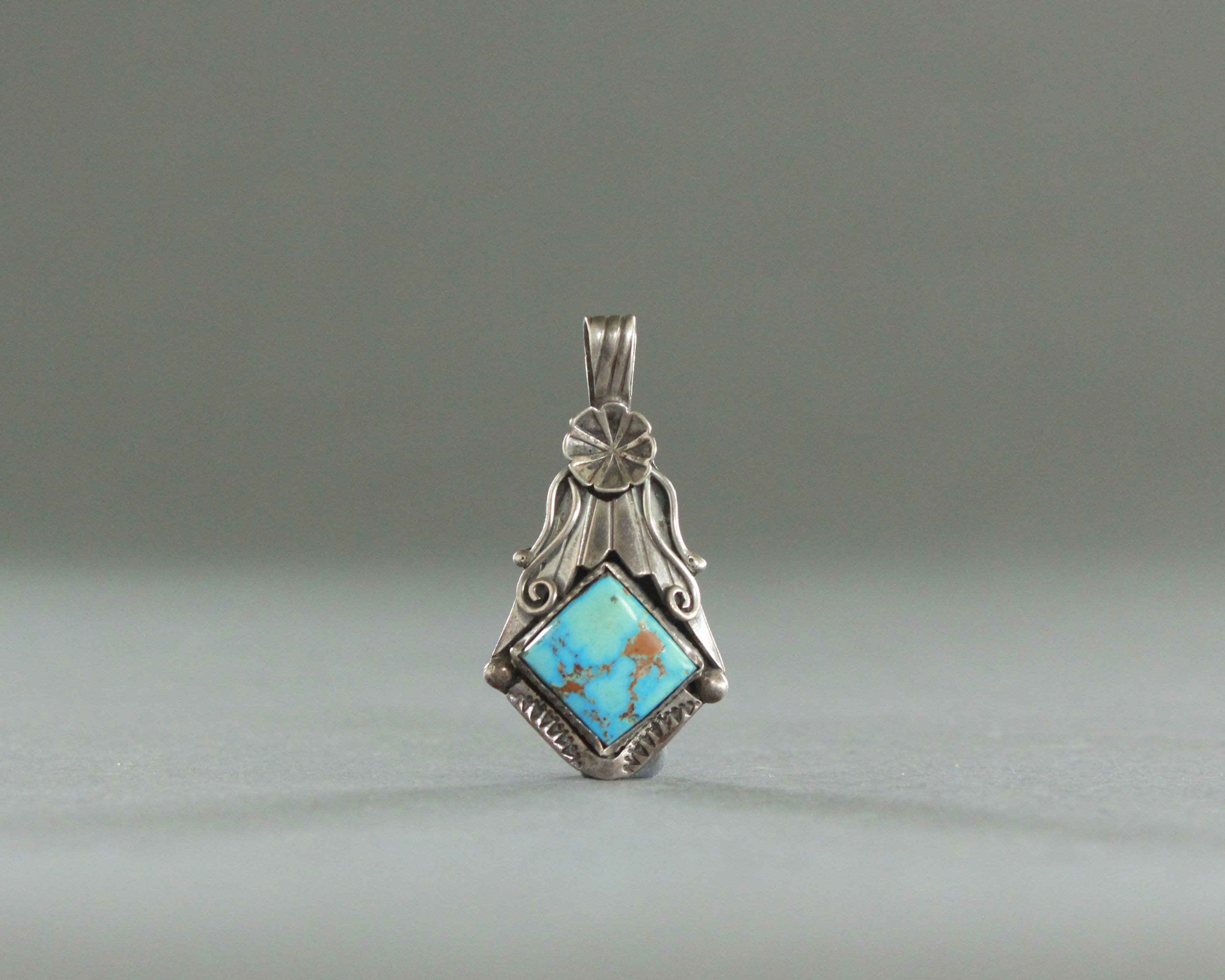 natural turquoise pendant with silver rose