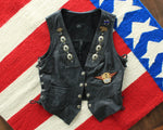 Vintage womens black leather biker vest with patches and pins, size small