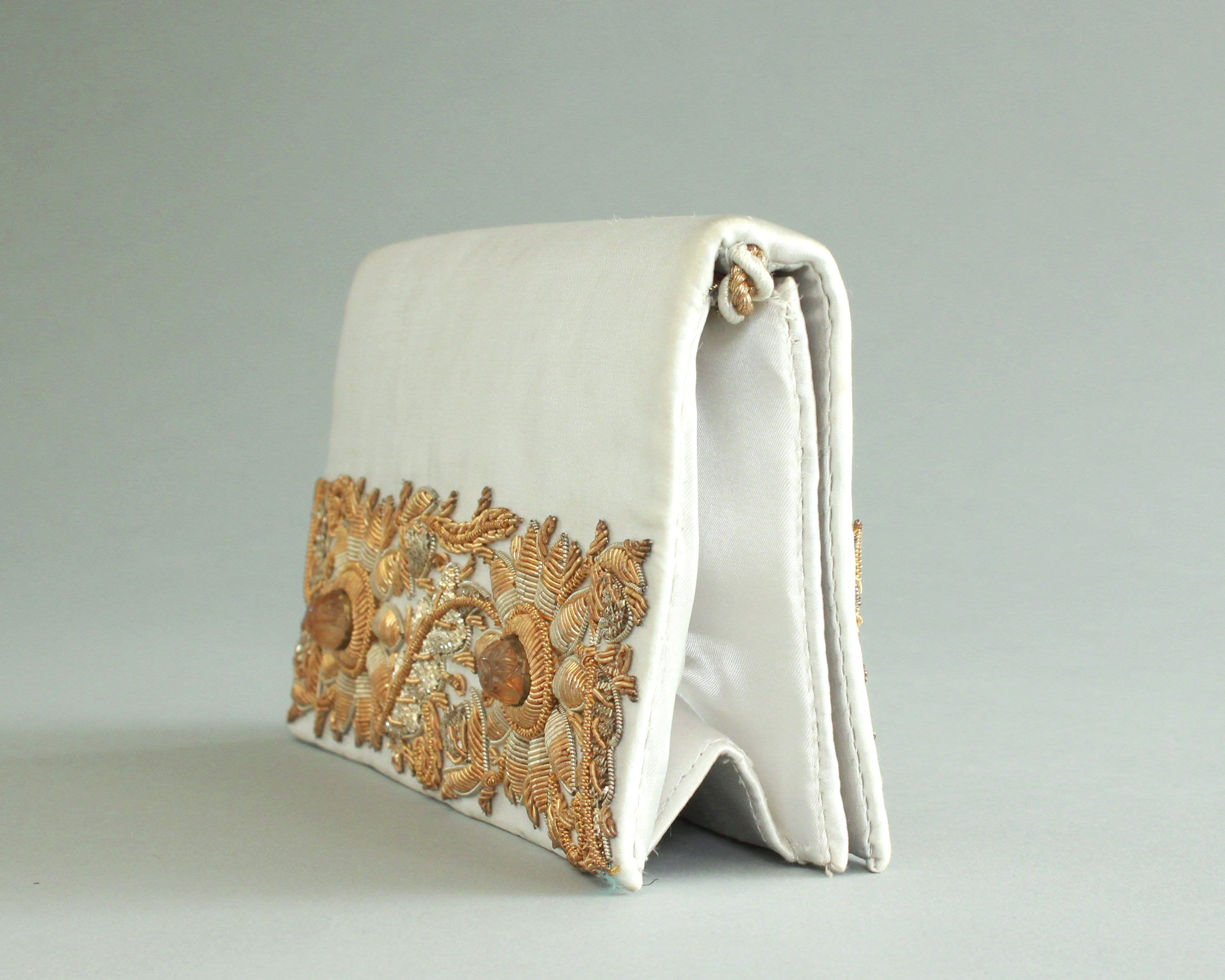 White satin purse with gold hand beading on both sides