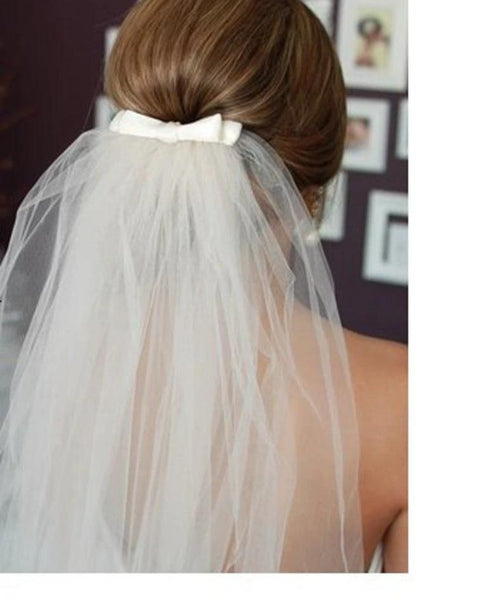 ivory wedding veil with bow details