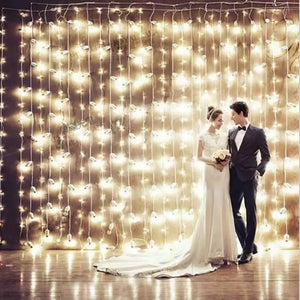warm fairy light curtain wedding backdrop