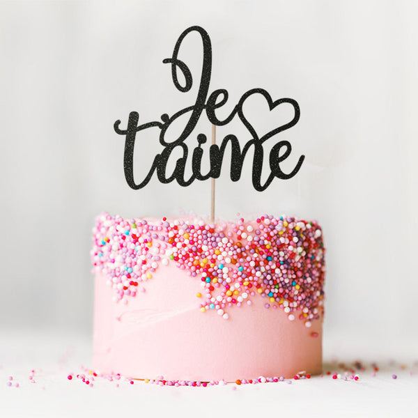 Je t'aime I love you wedding engagement black cake topper on top of pink cake