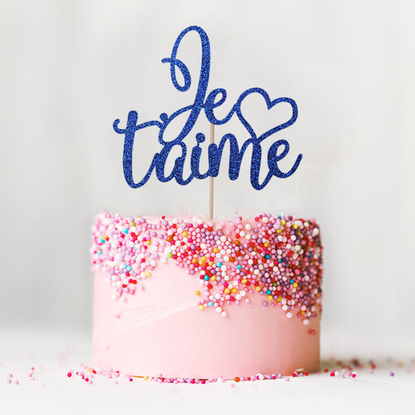 Je t'aime I love you wedding engagement blue cake topper on top of pink cake