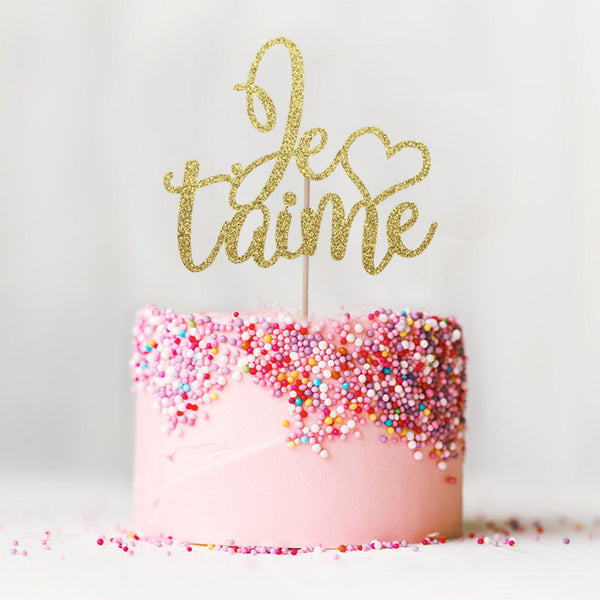 Je t'aime I love you wedding engagement gold cake topper on top of pink cake