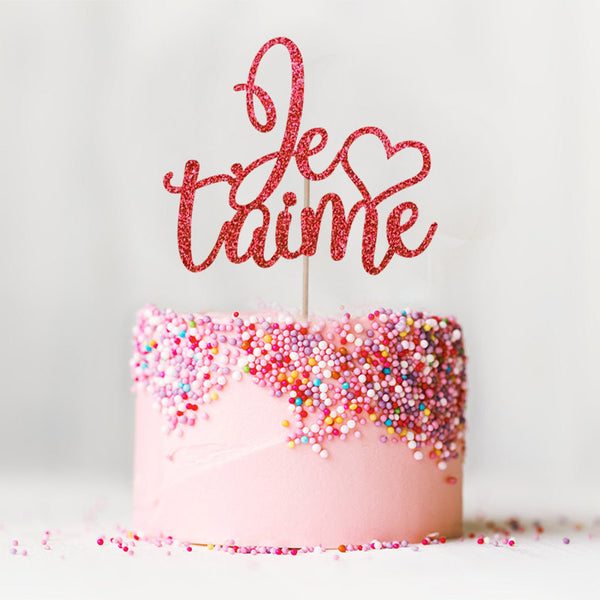 Je t'aime I love you wedding engagement red cake topper on top of pink cake