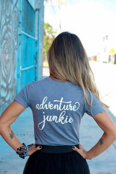 Female traveller wearing the Madly Addictive Adventure Junkie Tee