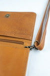 Cognac leather cross body, belt bag, clutch and wallet.