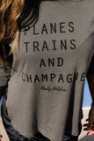 Female Traveller wearing Planes, Trains and Champagne Tee in Miami