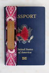 Passport Accessory, a Handmade Globetrotting Babe Passport Wrap with artisanal details and fabric.
