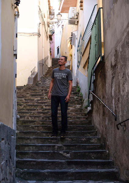 Male Traveller wearing Passport Gagster tee walking the streets in Almafi Coast.