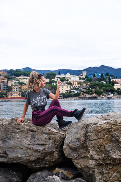 Female Traveller wearing Passport Gagster tee in Almafi Coast.