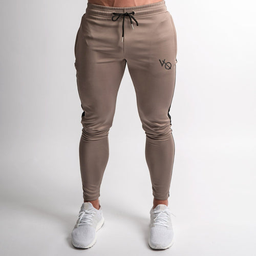 KHAKI TRICOT STRIKE TAPERED SWEATPANTS