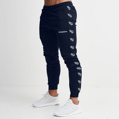 NAVY TRICOT STRIKE TAPERED SWEATPANTS