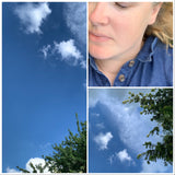 Girl in denim dress, laying under a blue sky, dreaming.