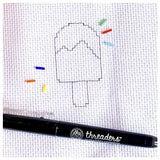 Picture of drawn lollipop on fabrice, with pen, and beads