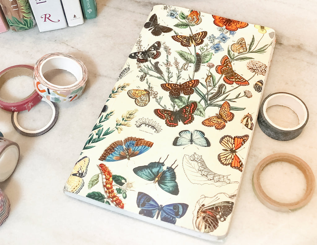 Undated planner with butterfly pattern cover.