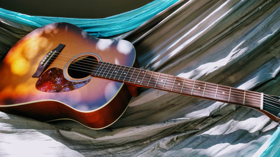Acoustic guitar Photo by Rebecca Swafford on Pexels
