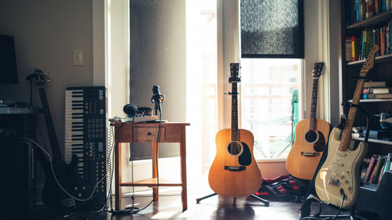 Guitars inside a room Photo by Wes Hicks on Unsplash