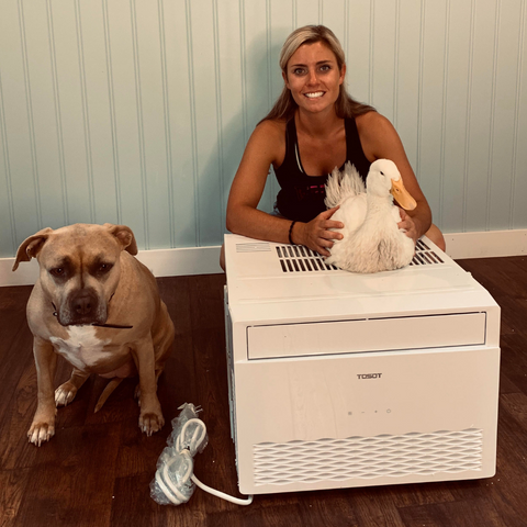 Woman with her pets and the TOSOT Window Air Conditioner