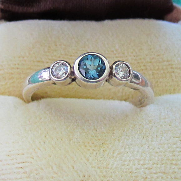 925 Sterling Silver Bezel Set Blue Topaz DEress Ring With 1 Clear Stone Either Side