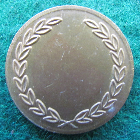 Token Blank Depicting A Wreath On The Face Side