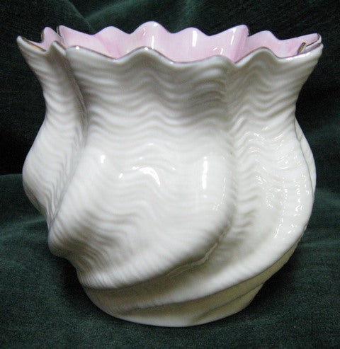 Irish Belleek shell vase with white opalescent body and pink/mauve inner rim with gilt edge