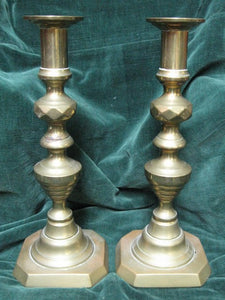 Pair of Late Victorian brass candlesticks with ejector rods