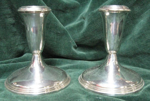 Pair of silver candlestick with weghted bases manufactured in America