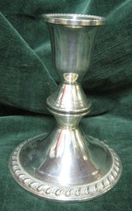 Silver candlestick with gadrooned weighted bases manufactured in America