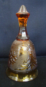 Fenton amber glass bell with faceted stem and high relief decorated body