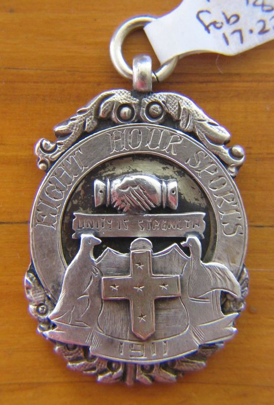 Sterling silver fob with gold overlayed Southern Cross depicting a kangaroo and emu with the inscription 'EIGHT HOUR SPORTS' 1911