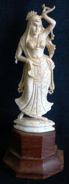 Ivory figure of a Dietie India late 19th century mounted on a rosewood base