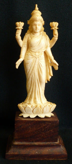 Ivory figure of Lord Vishnu standing on a Lotus flower India late 19th century mounted on a rosewood base