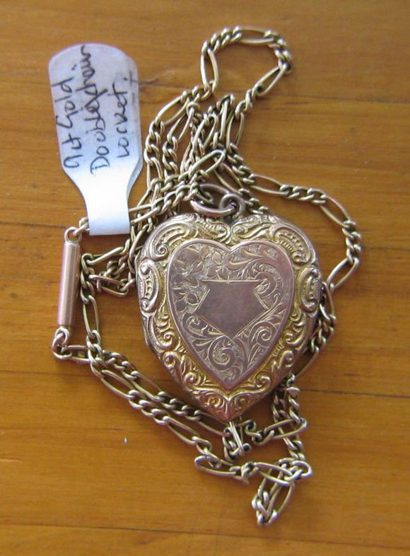 9ct rose gold heart shaped chased photo locket / pendant with chain. Car touche is unengraved.