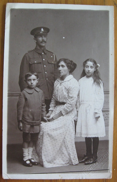 Postcard family portrait with British soldier & family