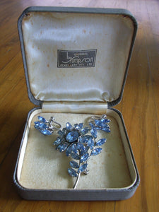 Donald Simpson blue Rhinestone / Diamante brooch  with matching earrings embossed to frame Simpson Jlry Pty Ltd in original box
