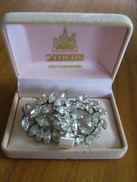 Donald Simpson clear Rhinestone / Diamante brooch embossed to frame Simpson Jlry Pty Ltd
