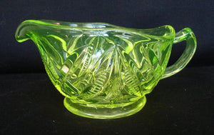 Yellow / green citrine / Citroen / uranium glass jug with footed molded body