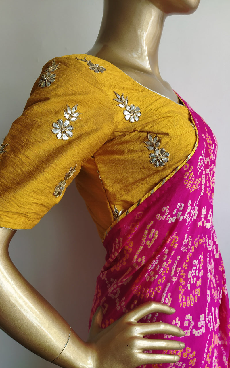 Fuschia Pink Bandhej Saree with Mustard Gota Patti Blouse