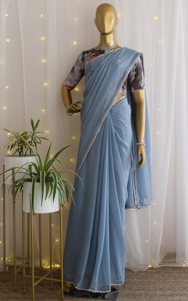 Powder Blue Mukaish Saree with Floral Blouse