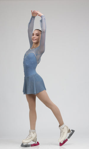 Stunning long sleeve pale blue Ice skating dress figure skating dress embroidered with Aurum Swarovski crystals.