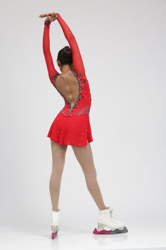 Red Figure Skating Dress Ice skating dress accented with Black Swarovski Crystals by Tania Bass