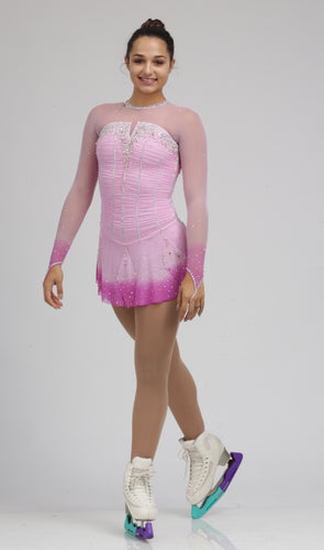 A fun/playful pink ice skating dress figure skating dress by Tania Bass