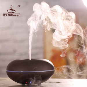 GX.Diffuser Colorful LED Light Changing Ultrasonic Air Purifier Essential Oil Aroma Humidifier Aromatherapy Mist Maker. Colors: light wood, dark wood, white ,and black.