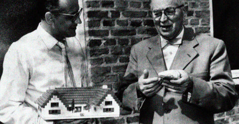 Lego founder speaking to a man